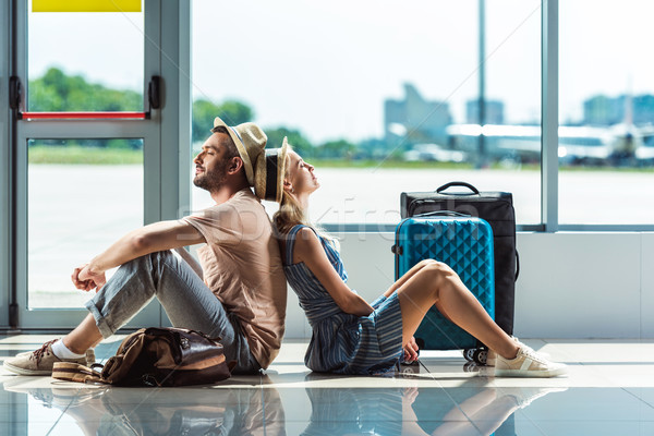 couple waiting for boarding in airport Stock photo © LightFieldStudios