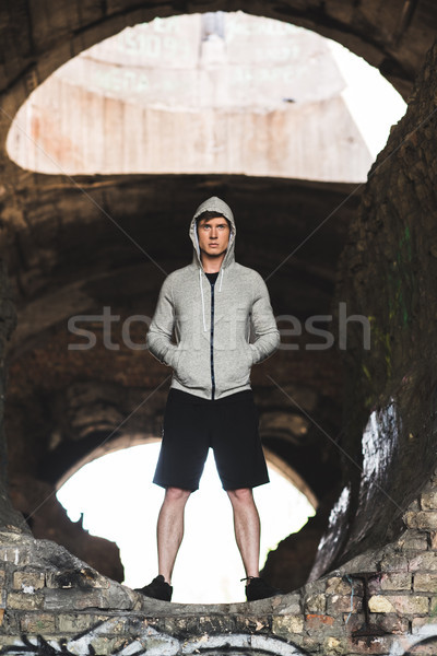 young man in hoodie Stock photo © LightFieldStudios