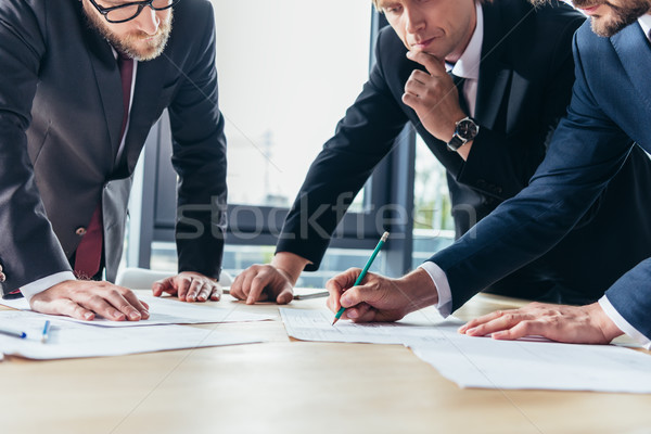 businessmen working in office Stock photo © LightFieldStudios