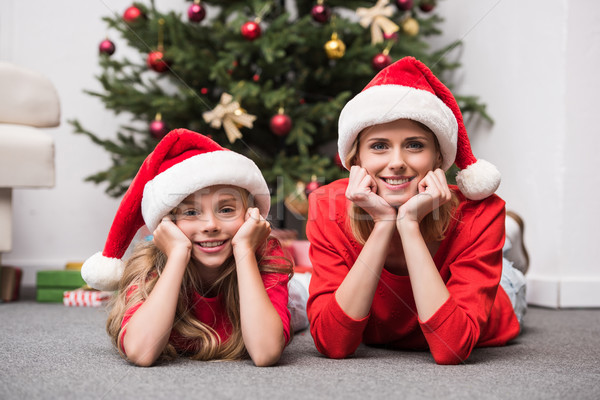 mother and daughter at christmastime Stock photo © LightFieldStudios