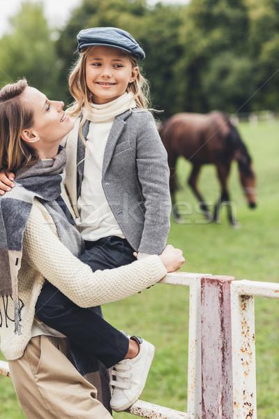 happy family at paddock with horse Stock photo © LightFieldStudios