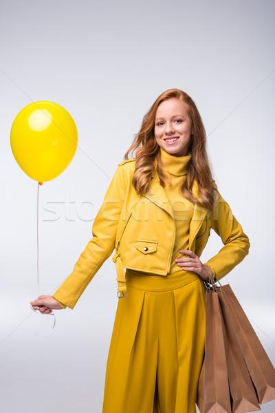 girl in yellow jacket with balloon Stock photo © LightFieldStudios