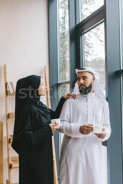 muslim couple drinking coffee Stock photo © LightFieldStudios