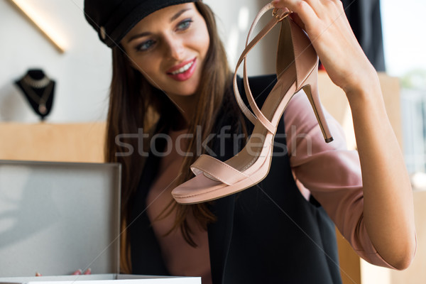 young woman choosing shoes Stock photo © LightFieldStudios