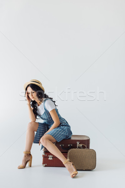 tired woman sitting on luggage Stock photo © LightFieldStudios