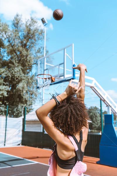 african-american throwing basketball Stock photo © LightFieldStudios