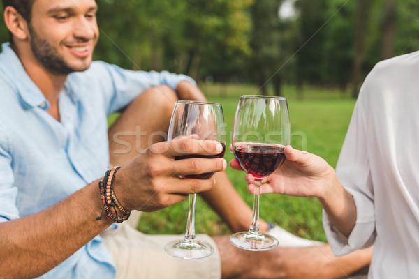 couple clinking glasses of wine on date Stock photo © LightFieldStudios