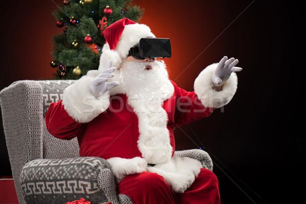 Santa Claus wearing virtual reality headset Stock photo © LightFieldStudios