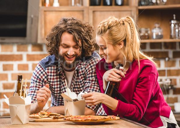 Couple eating noodles Stock photo © LightFieldStudios