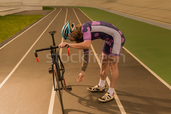 Bisikletçi devir yarış pisti yandan görünüş bisiklet tekerlek Stok fotoğraf © LightFieldStudios