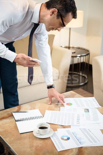 Biznesmen czytania formalności formalny nosić okulary Zdjęcia stock © LightFieldStudios