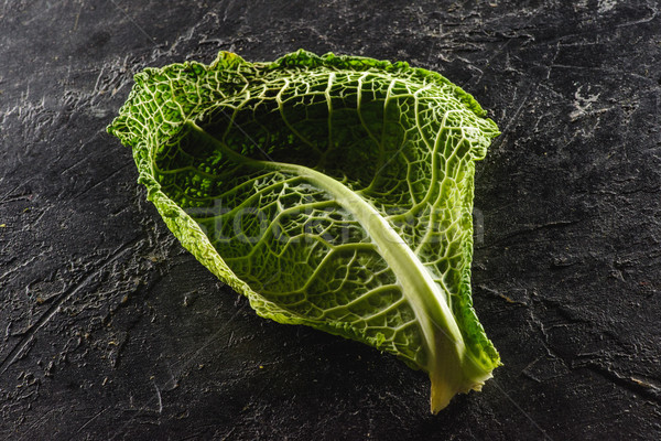 close-up view of leaf of fresh healthy savoy cabbage on black   Stock photo © LightFieldStudios