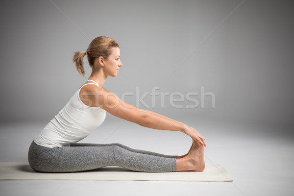 Woman sitting in yoga position  Stock photo © LightFieldStudios