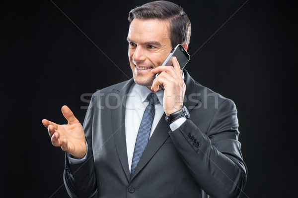 Businessman talking on mobile phone Stock photo © LightFieldStudios