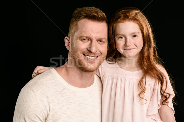 Vörös hajú nő apa imádnivaló lánygyermek néz kamera Stock fotó © LightFieldStudios
