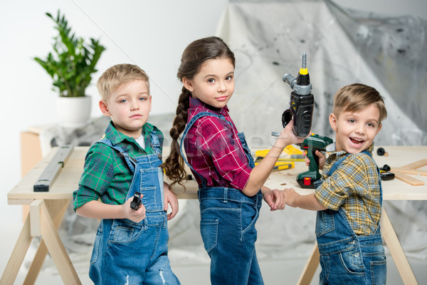 Happy kids with tools Stock photo © LightFieldStudios