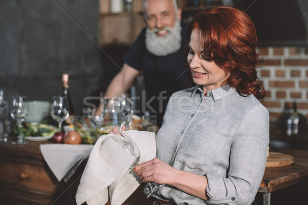 woman cleaning wine glass Stock photo © LightFieldStudios