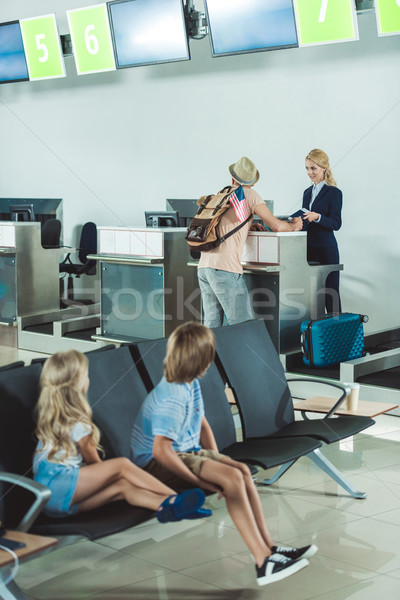 Stock photo: man at check in desk at airport