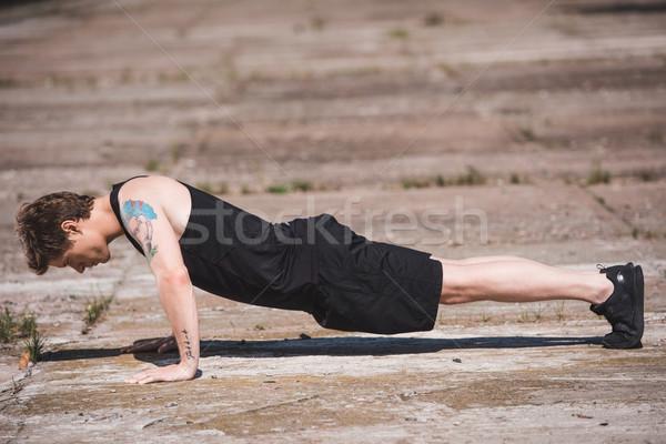 man doing push ups Stock photo © LightFieldStudios