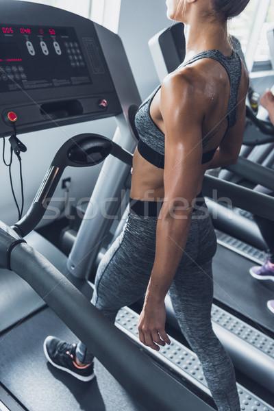 woman exercising on treadmill Stock photo © LightFieldStudios