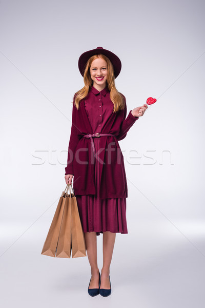 Menina pirulito sorridente elegante coração Foto stock © LightFieldStudios