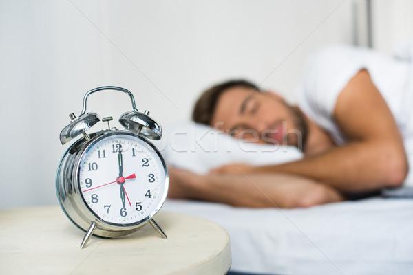 alarm clock on bedside table Stock photo © LightFieldStudios