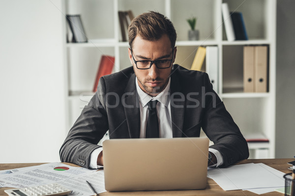 businessman working with laptop Stock photo © LightFieldStudios