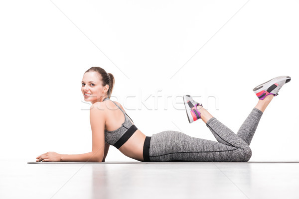 sportswoman on yoga mat Stock photo © LightFieldStudios