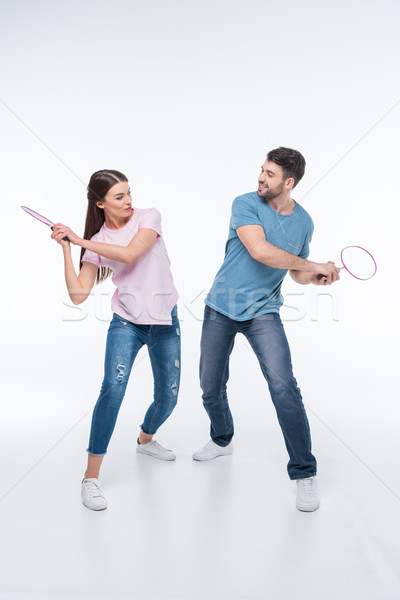 couple playing with badminton rackets on white Stock photo © LightFieldStudios