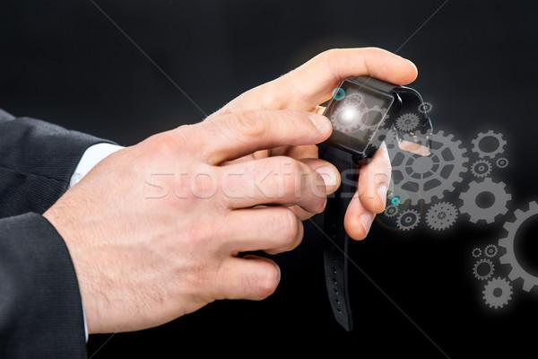 Businessman using smart watch Stock photo © LightFieldStudios