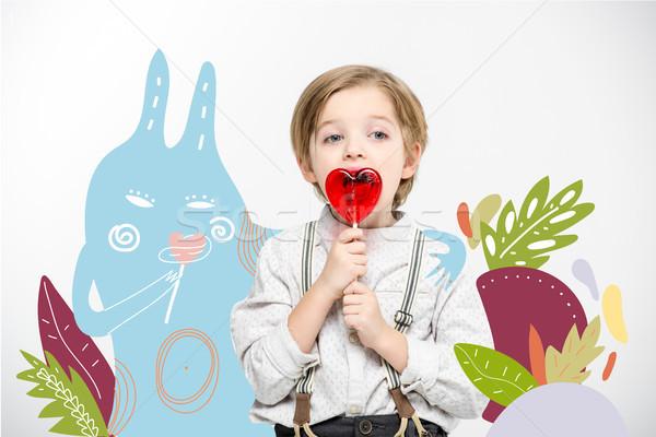 Cute little boy with lollipop Stock photo © LightFieldStudios