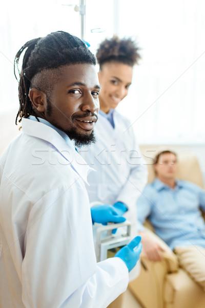 врач больницу комнату молодые лабораторный халат Сток-фото © LightFieldStudios