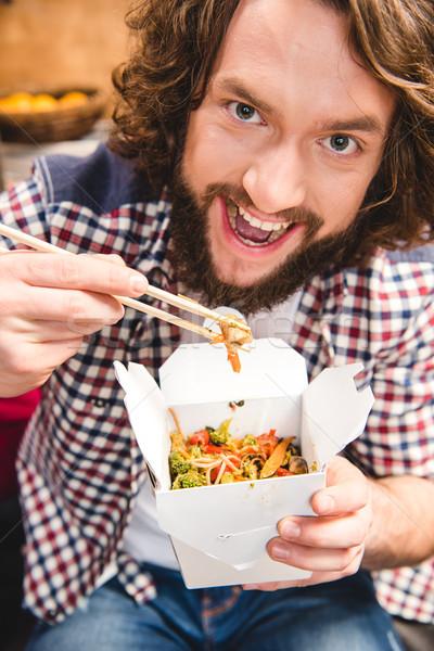 Man eating noodles Stock photo © LightFieldStudios