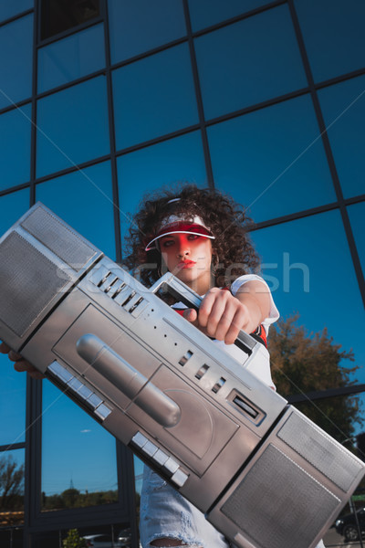 woman showing boombox Stock photo © LightFieldStudios