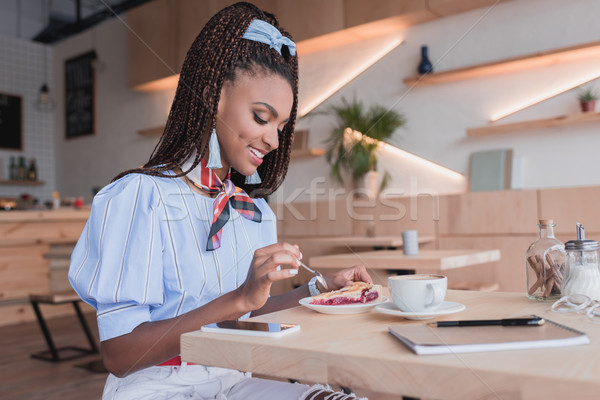 african american woman eating pie in cafe Stock photo © LightFieldStudios