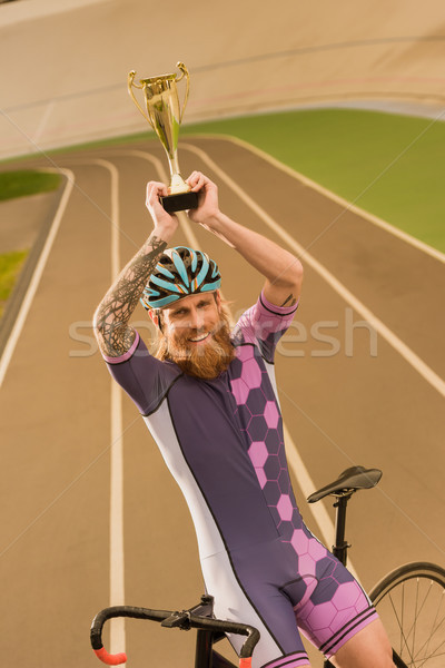 cyclist with champion cup Stock photo © LightFieldStudios