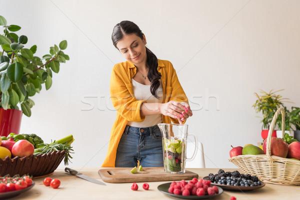 woman preparing detox drink Stock photo © LightFieldStudios