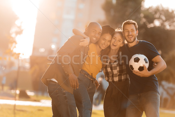multicultural friends with soccer ball Stock photo © LightFieldStudios
