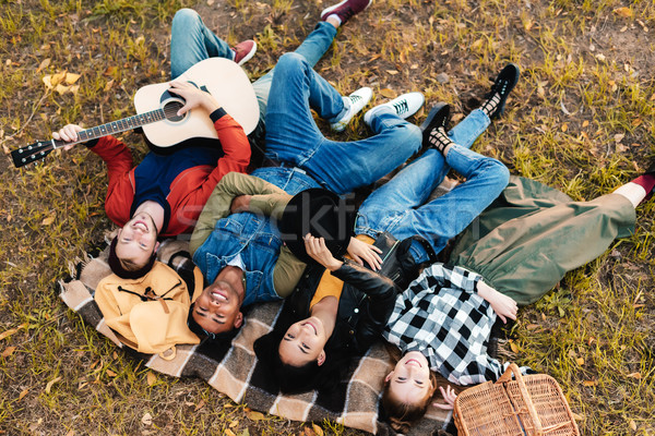 Multikulturális barátok pihen pléd együtt magasról fotózva Stock fotó © LightFieldStudios