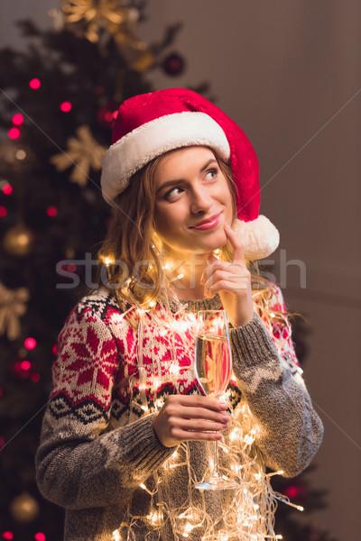 girl in santa hat drinking champagne Stock photo © LightFieldStudios