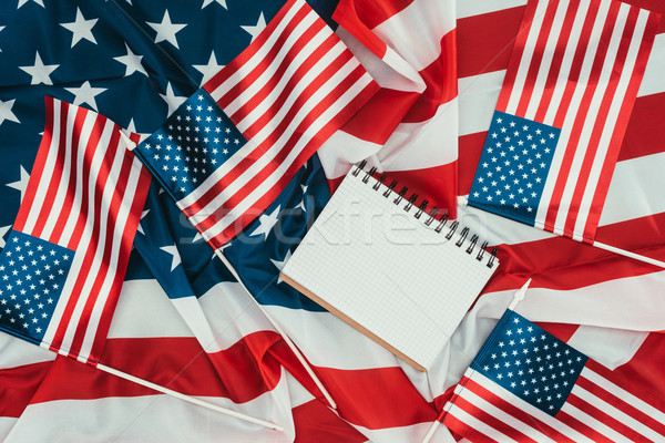 Felső kilátás amerikai zászlók notebook nap Stock fotó © LightFieldStudios