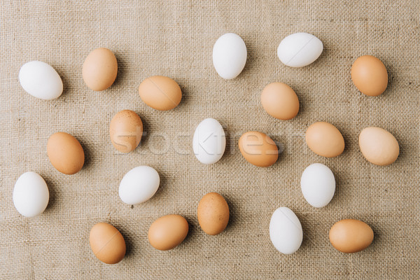 white and brown eggs scatterd on sackcloth Stock photo © LightFieldStudios