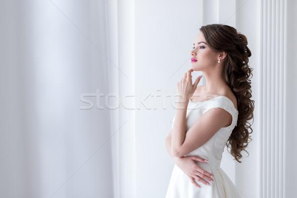 Figyelmes fiatal menyasszony esküvői ruha nő lány Stock fotó © LightFieldStudios