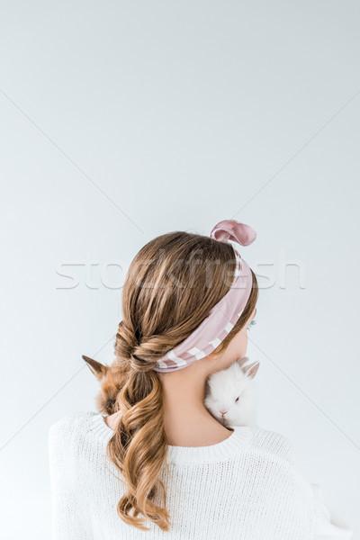 Hátulnézet lány tart imádnivaló szőrös nyulak Stock fotó © LightFieldStudios