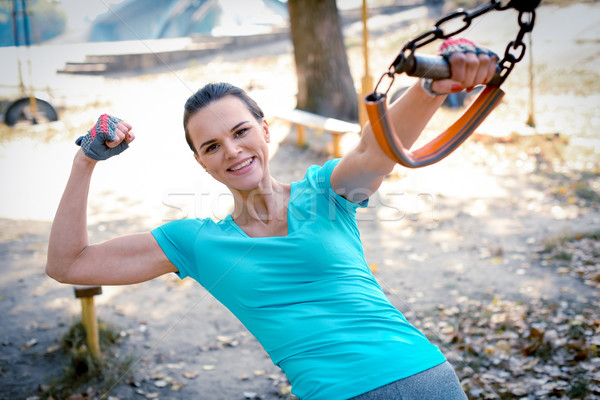 Woman showing her bicep Stock photo © LightFieldStudios