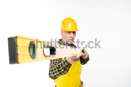 Workman with level tool Stock photo © LightFieldStudios
