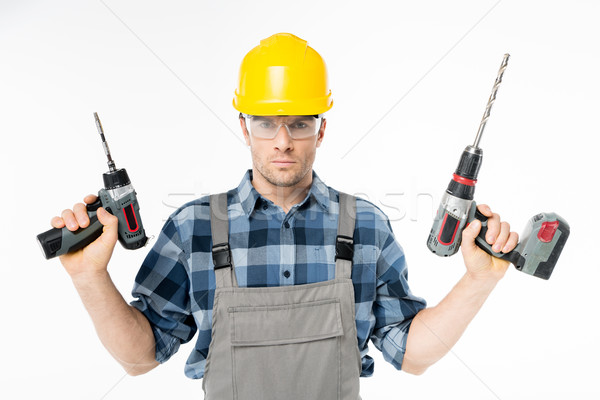 Workman holding electric drills Stock photo © LightFieldStudios