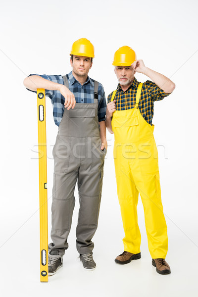 Workmen with level tool Stock photo © LightFieldStudios