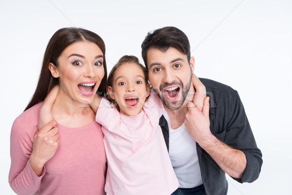 Heyecanlı genç aile çığlık atan kamera Stok fotoğraf © LightFieldStudios
