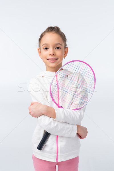 portrait of smiling girl holding badminton racket on white Stock photo © LightFieldStudios